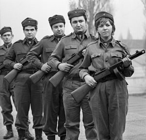 "Workers' Militia - Slate grey clad Hungarian workers' guards and their PPSh-41 sub-machine guns. With a lightweight, fold-up shoulder strap, it was made in Hungary for a version of the Armed Forces (""Armed Forces""). This basic weapon was used by the Workers' Guard until the early 1970s."