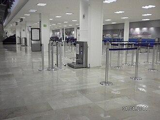 Licenciado Gustavo Díaz Ordaz International Airport - Airport ticket counters.