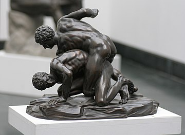 A bronze smaller reproduction in Munich of a Roman marble after a 3rd c.BC Greek depiction of pankratists grappling and striking