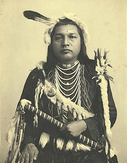 Paul Shoaway, a Native of the Umatilla tribe in the Columbia Plateau region, 1899 Paul Shoaway, Umatilla Indian, in ceremonial dress, Washington (4951753872).jpg