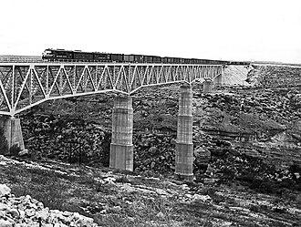 Pecos River High Bridge - Southern Pacific Railroad train on bridge, 1951