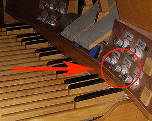 Tutti - The tutti piston seen over the organ pedalboard