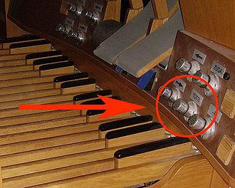 Tutti - The tutti piston seen over the organ pedalboard
