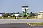 Pel-Air Saab 340B (VH-ZXS) in former Happy Air Travellers livery parked on the tarmac at Wagga Wagga Airport.jpg