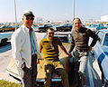 Pete Conrad (left), Dick Gordon, and Al Bean pose with one of their matched set of Corvettes.jpg