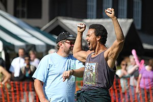 Pamyua - Phillip Blanchett in August 2014.  He was participating in the highland games in Sitka and is shown celebrating a successful caber toss.