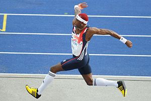 Phillips Idowu - Idowu on the way to his first World Championships title in 2009 with a broken arm