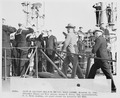 Photograph of President Truman and Vice Admiral Aubrey Fitch being piped aboard a submarine, the U.S.S. TUSK, during... - NARA - 198650.tif