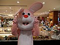 Pink Easter bunny with victory pose.jpg