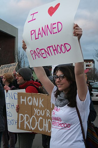 Planned Parenthood - A Planned Parenthood supporter participates in a demonstration in support of the organization