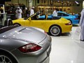 Porsche Boxster, 911 Carrera Cabrio and 911 GT3 at the Dubai Motor Show.jpg