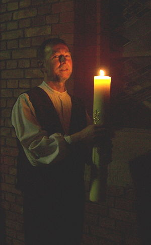 Lutheran deacon with Easter candle