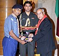 Pranab Mukherjee presenting the Silver Star Award 2011-2012 to the Assistant State Organizing Commissioner (Scouts) of North Eastern Railway State Bharat Scouts & Guides, Shri Partha Sarathi Biswas.jpg