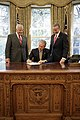 President George W. Bush signs S. 418, The Military Personnel Financial Services Protection Act, in the Oval Office.jpg