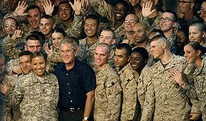 U.S. Service members gather around President G...