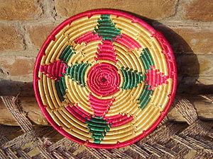 Pakistani cuisine - A Punjabi/Sindhi-style wooden woven plate for chapati (flat bread)