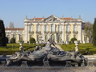 Queluz, Portugal - The front facade of the Queluz National Palace, with one of the ornate fountains