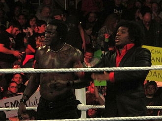 Xavier Woods - Woods (right) in the ring with R-Truth in January 2014