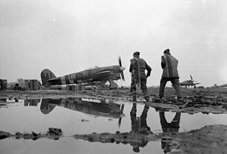 Royal Canadian Air Force - Two armourers of No 440 Squadron RCAF re-arming a Hawker Typhoon in the Netherlands, 1944.