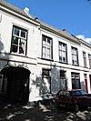 foto van Pand met verdieping en zadeldak, tussen puntgevels, evenwijdig aan de straat, wellicht 18e eeuw