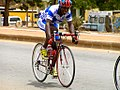Racing cyclist in Ouagadougou, Burkina Faso, 2009.jpg