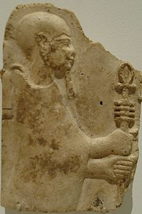 Stucco relief of Ptah with staff and ankh and djed.  Late Period or Ptolemaic Dynasty, 4th to 3rd century BC.