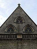 Reuleaux triangle shaped windows of Sint-Michielskerk, Ghent.jpg