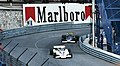 Riccardo Patrese - Shadow DN8 - leads Jacky Ickx - Ensign N177 at Tabac at the 1977 Monaco GP.jpg