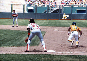 Left fielder - Hall of fame left fielder Rickey Henderson attempting a steal. Henderson holds both the single season and career stolen base records.