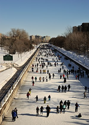 Continental climate - Ice skaters on the frozen Rideau Canal, looking south from Laurier Avenue Bridge in Ottawa