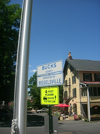 Riegelsville, Pennsylvania - Signs on the approach for the Riegelsville Bridge denoting entrance into Riegelsville. The Riegelsville Inn can be seen in the background.