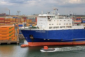 P&O Ferries - A tug passes M/V Norqueen at Teesport, which operates the freight-only RORO route to Rotterdam.
