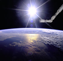 Robot Arm Over Earth with Sunburst - GPN-2000-001097.jpg