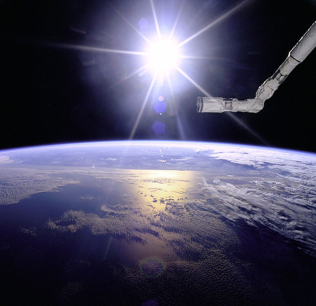 File:Robot Arm Over Earth with Sunburst - GPN-2000-001097.jpg