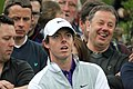 Rory McIlroy watches drive (no club).jpg