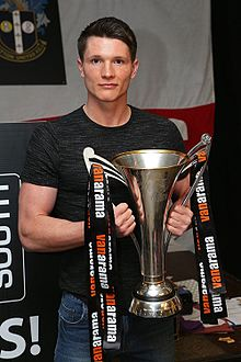 Ryan Burge with National League South trophy.jpg