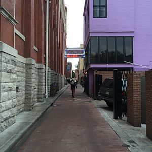 "Ryman Auditorium - Alley between Ryman Auditorium and the rear of Broadway ""Honky Tonks"", including Tootsie's Orchid Lounge."