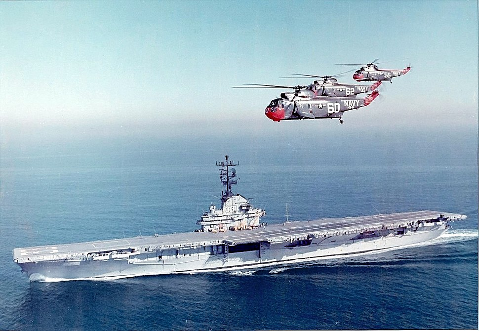 SH-3A Sea Kings of HS-6 flying over USS Kearsarge (CVS-33) c1963