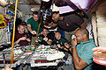 STS-129 ISS-21 Crew at the Galley.jpg