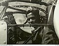 Sabu Dastagir seated over the nose guns of a US Consolidated B24 Liberator bomber 1941.jpg
