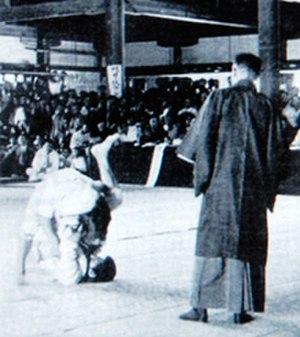 Triangle choke - The triangle choke applied at an early judo tournament.