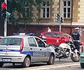 Serbian police motor cycle with police car 01.jpg
