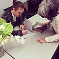 Signing my book at the Fashion Institute of Technology (15550629511).jpg