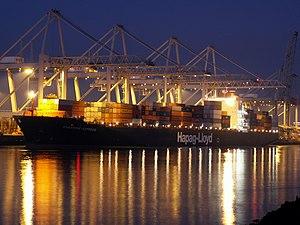 Singapore Express by night approaching Port of Rotterdam, Holland 24-Jan-2006.jpg