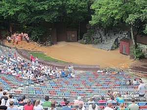 Unto These Hills - Singers perform on the left side of the amphitheater before the play begins and the audience gathers.