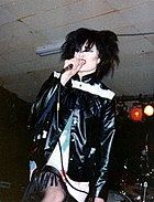 Siouxsie Sioux performing on stage