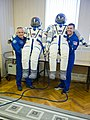 Soyuz MS-04 crew members with their space suits.jpg