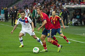 Nacho Monreal - Monreal taking on Chile's Eduardo Vargas in a 2013 friendly