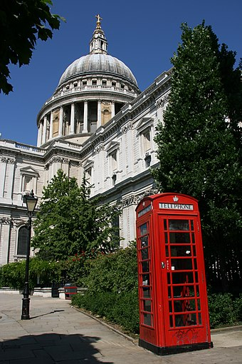 A red telephone box in front of St Paul's Cathedral, one of the most important buildings of the English Baroque period St Pauls Cathedral, London.jpg