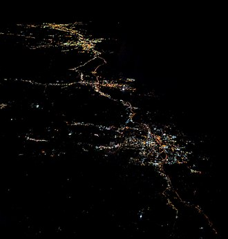 Stamford, Connecticut - Night aerial view of Stamford from the west, with Norwalk, Bridgeport, and New Haven behind to the northeast.  The dark area in the upper right is the Long Island Sound.